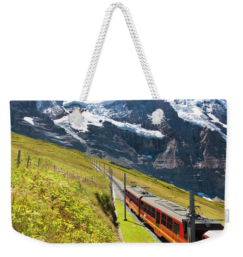 Scenics Weekender Tote Bag featuring the photograph Jungfraubahn, Swiss Alps by Michaelutech
