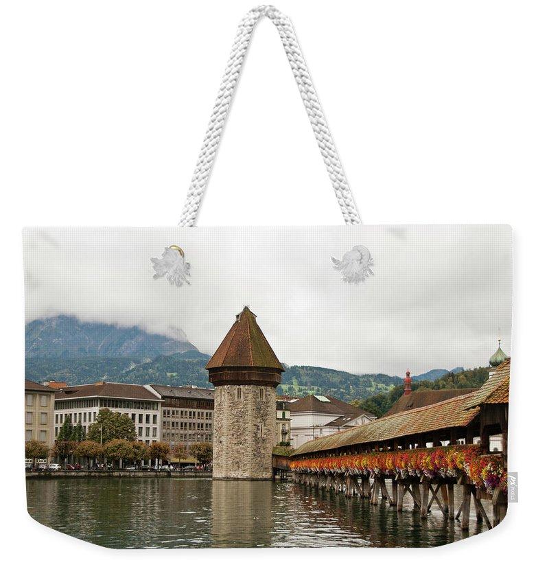 Scenics Weekender Tote Bag featuring the photograph Kapellbrucke On Reuss River, Lucerne by Cultura Rf/rosanna U