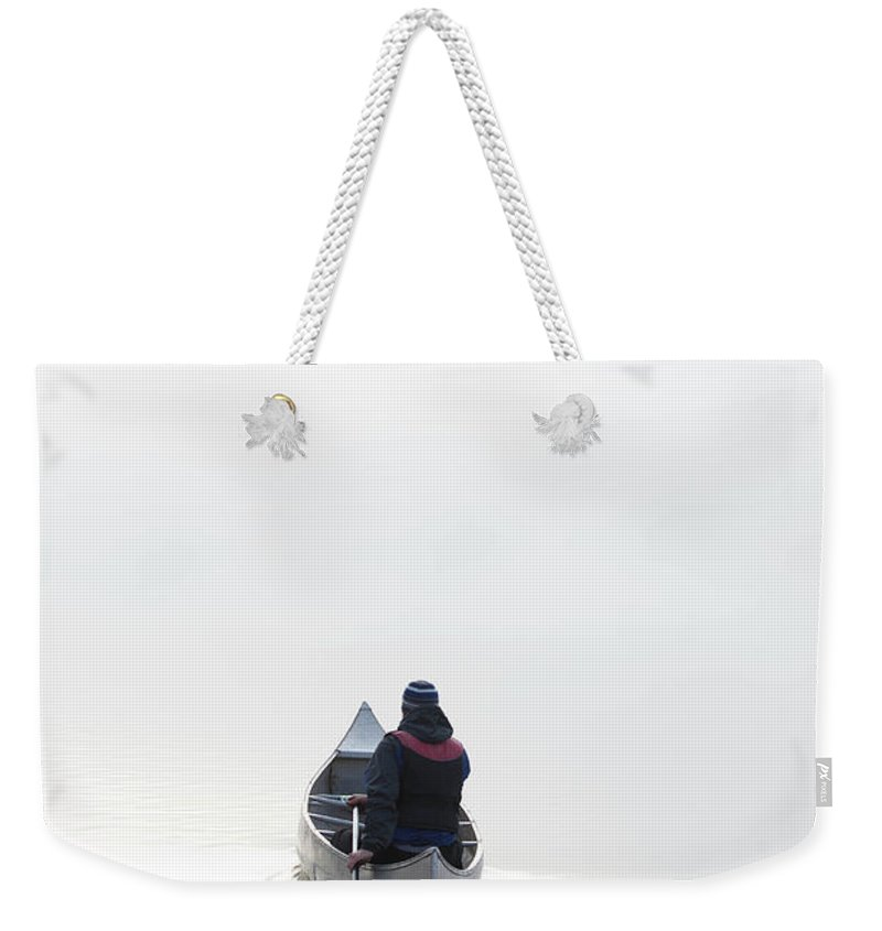 Scenics Weekender Tote Bag featuring the photograph Kayaking In The Morning Mist by Ross Woodhall