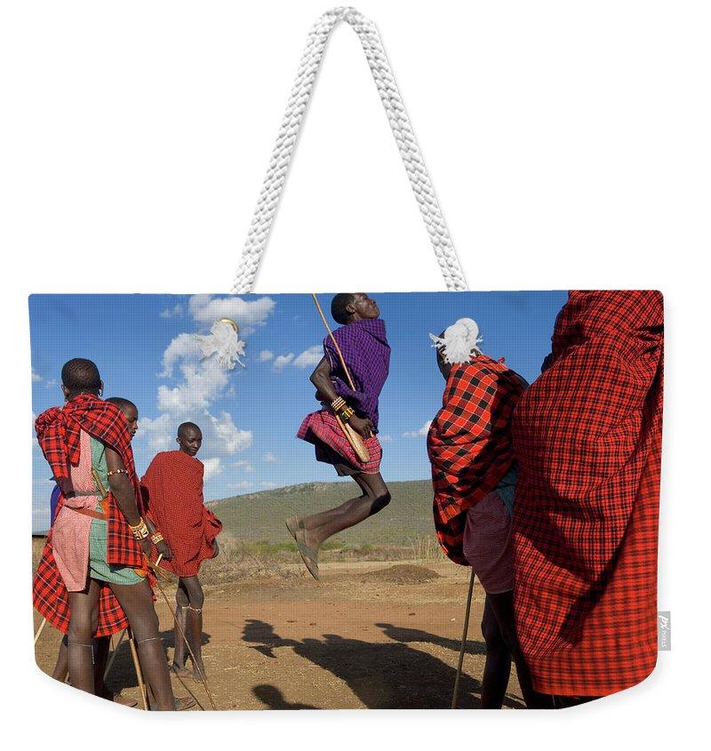 Young Men Weekender Tote Bag featuring the photograph Kenya, Masai Mara, Masai Dancers by Peter Adams