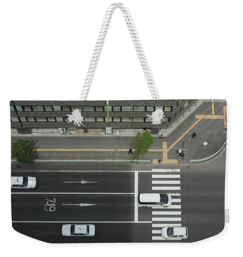 Hokkaido Weekender Tote Bag featuring the photograph Land Vehicles Crossing Pedestrian by Iyoupapa
