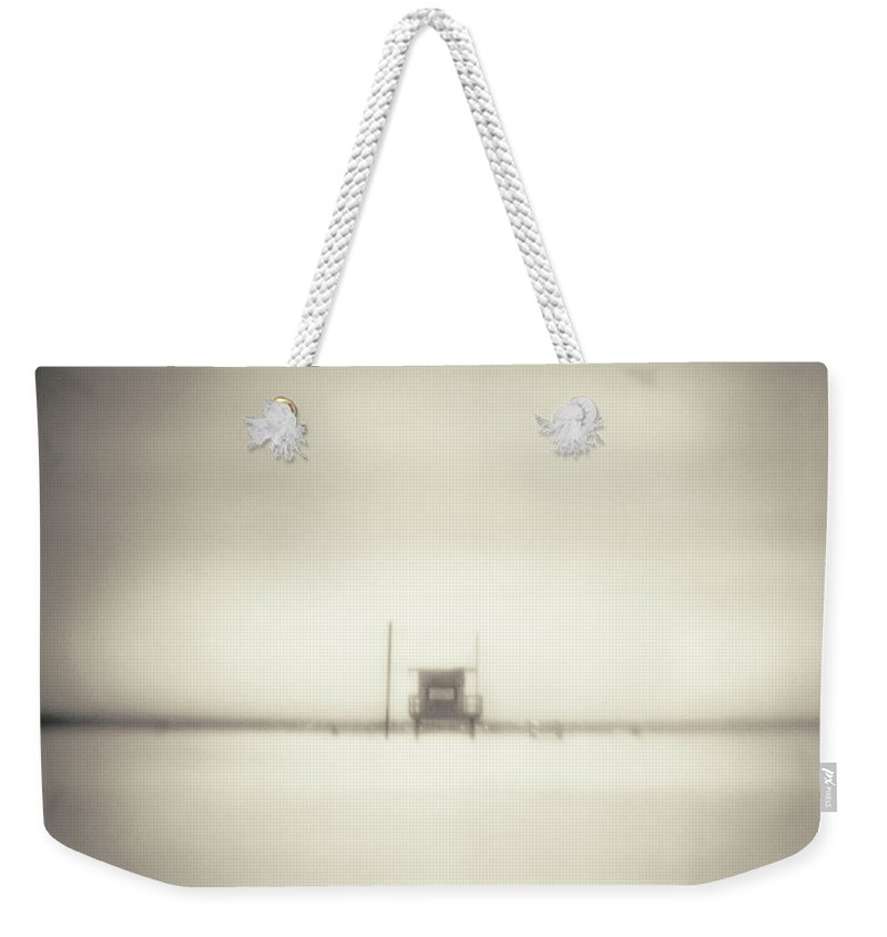 California Weekender Tote Bag featuring the photograph Lifeguard Hut On Santa Monica Beach by Alan Horsager