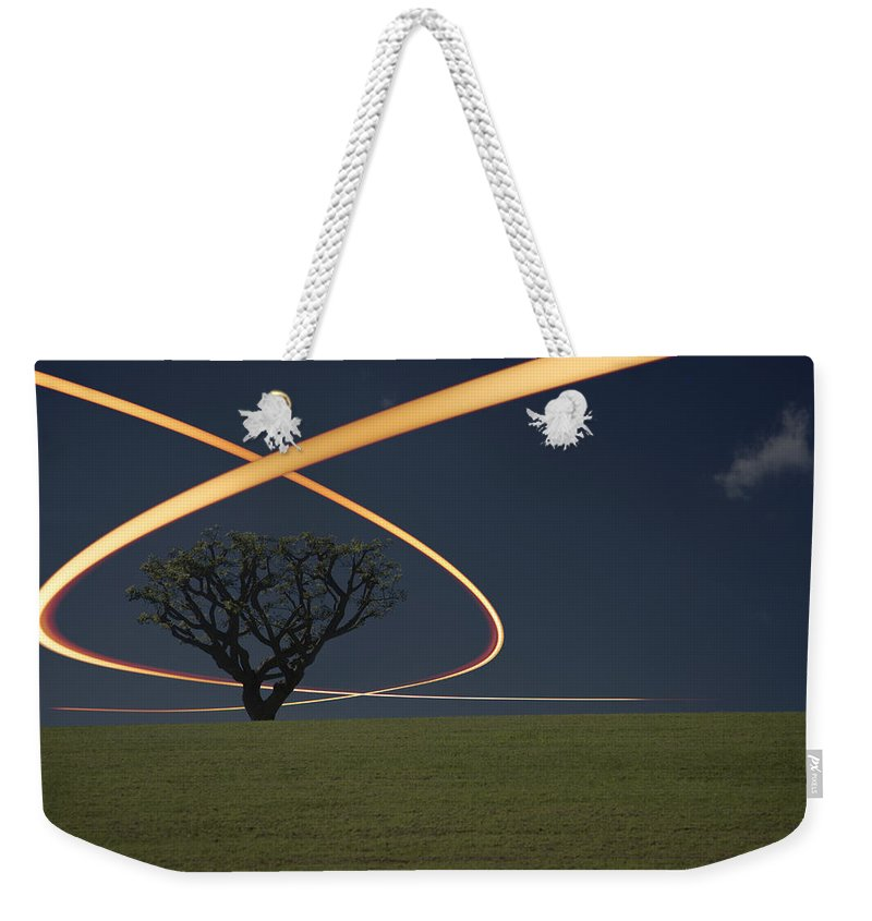 Scenics Weekender Tote Bag featuring the photograph Light Trails Around Tree by Paul Taylor