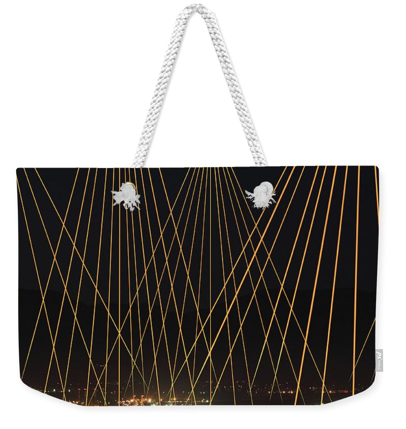 Corporate Business Weekender Tote Bag featuring the photograph Light Trails Beaming Down On City by Paul Taylor