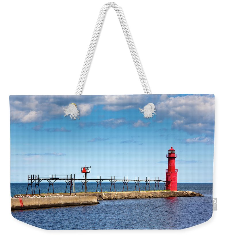 Lake Michigan Weekender Tote Bag featuring the photograph Lighthouse And Pier On Lake Michigan by Jamesbrey