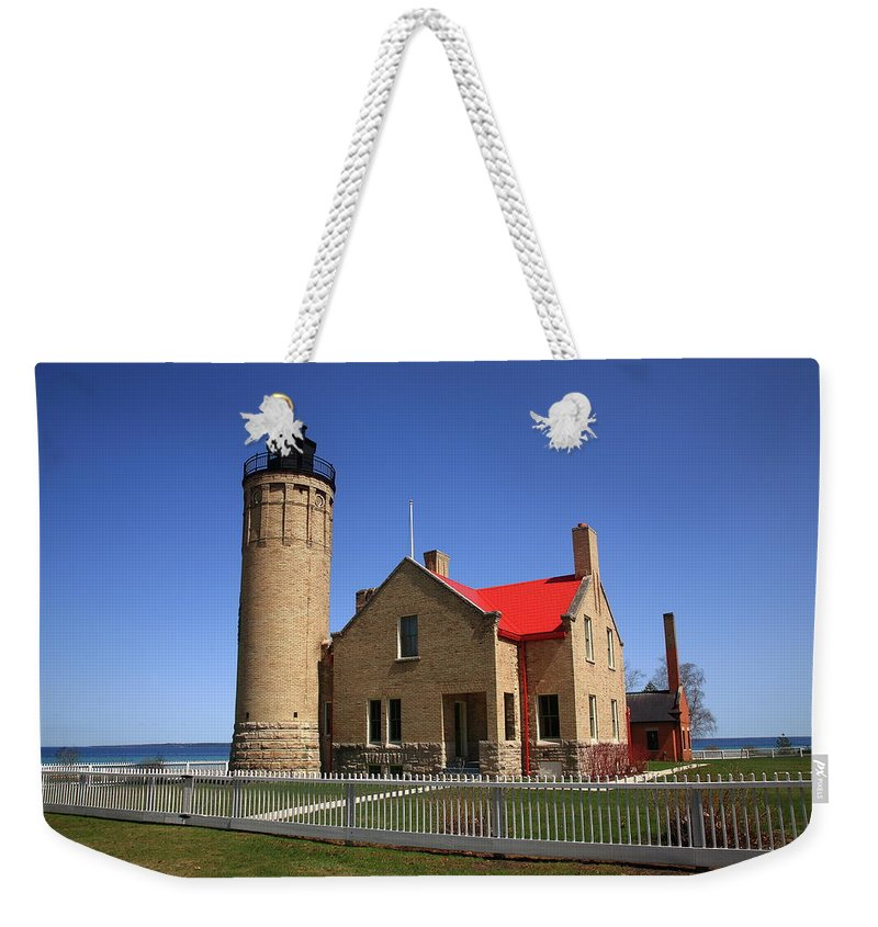America Weekender Tote Bag featuring the photograph Lighthouse - Mackinac Point Michigan by Frank Romeo