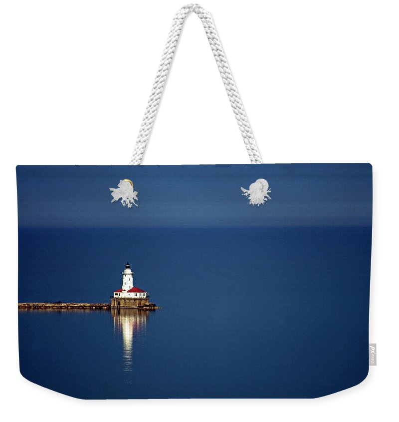 Outdoors Weekender Tote Bag featuring the photograph Lighthouse On A Lake by By Ken Ilio
