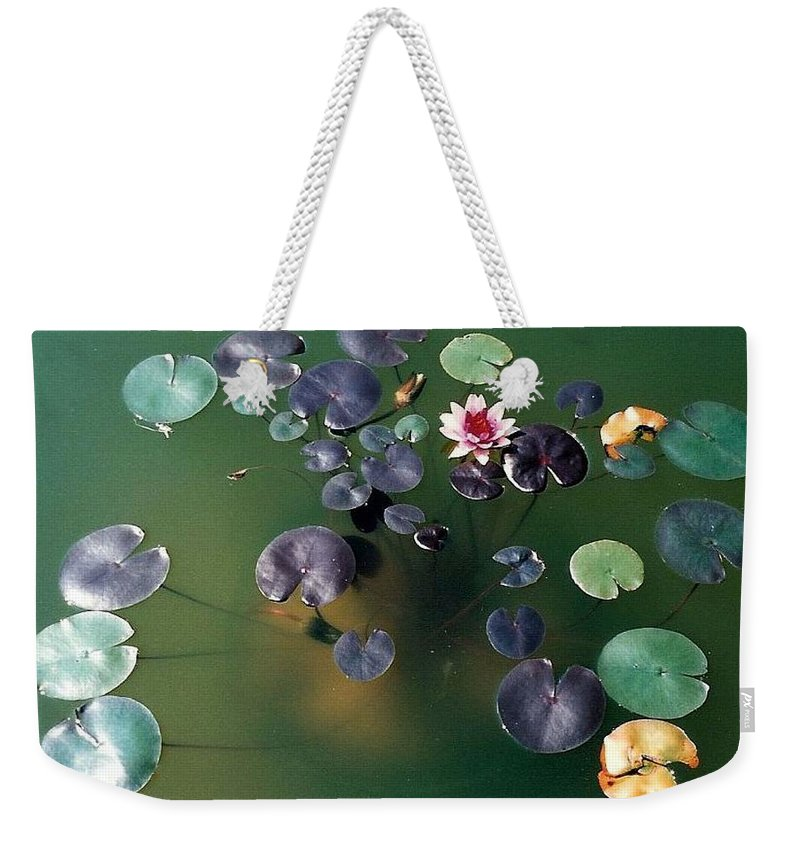 1980-1989 Weekender Tote Bag featuring the photograph Lillypad by Margherita Wohletz