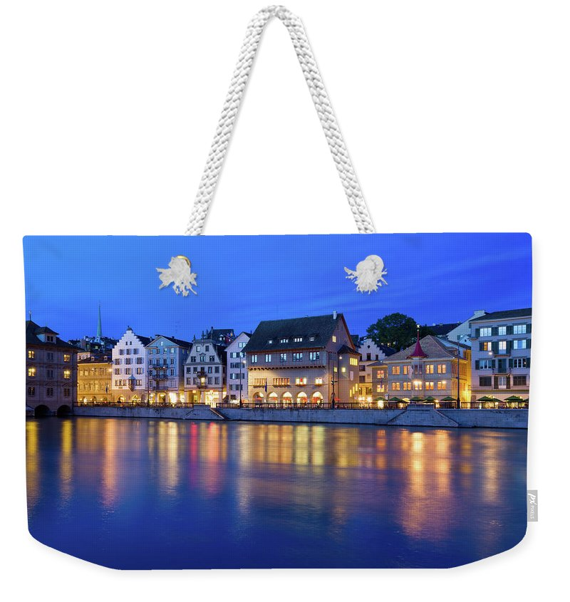 Zurich Weekender Tote Bag featuring the photograph Limmat River Waterfront In Downtown by Benedek