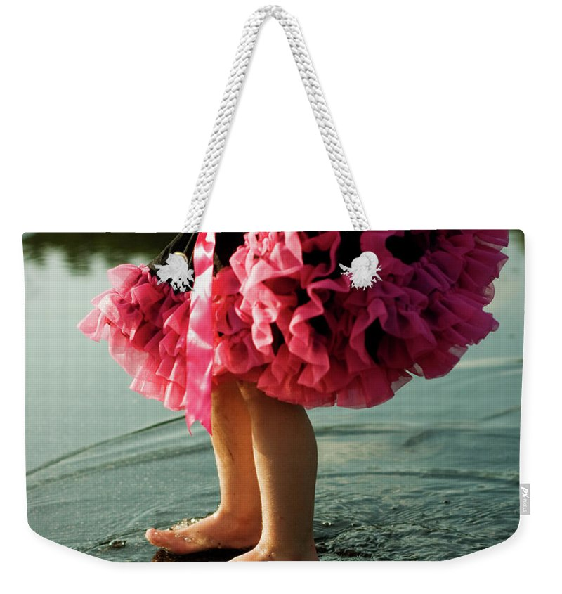 Toddler Weekender Tote Bag featuring the photograph Little Girls Feet Splashing And Dancing by Ssj414