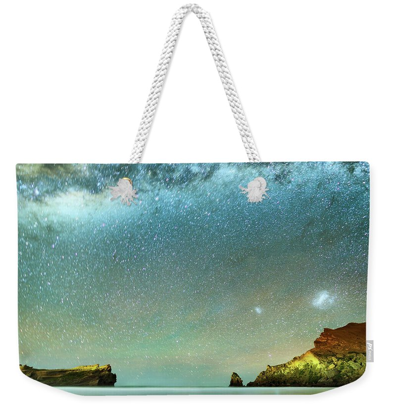 Galaxy Weekender Tote Bag featuring the photograph Long Exposure Of Stars by Piskunov