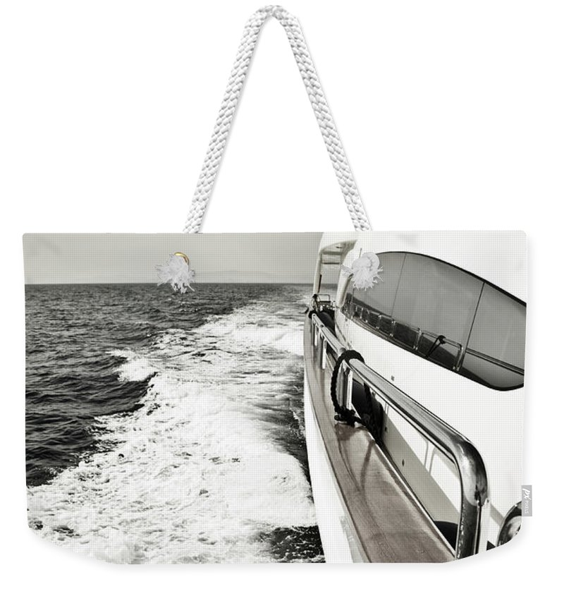 Desaturated Weekender Tote Bag featuring the photograph Luxury Yacht Sailing At High Speed In by Petreplesea