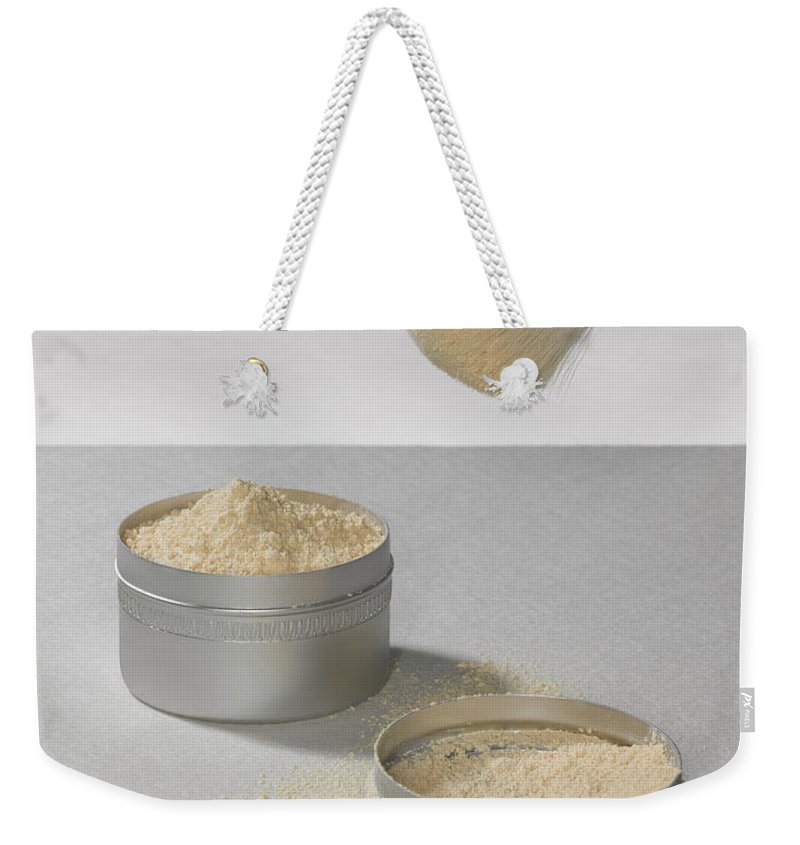 Heap Weekender Tote Bag featuring the photograph Make Up Powder by Adrian Burke