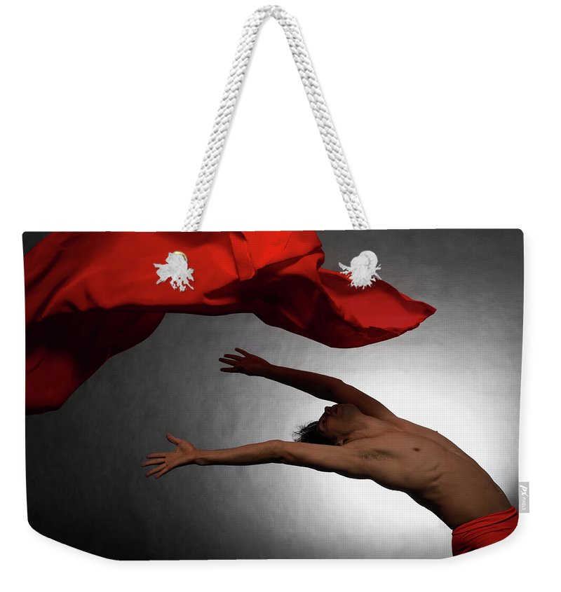 Ballet Dancer Weekender Tote Bag featuring the photograph Male Ballet Dancer Dancing With A Red by Win-initiative/neleman