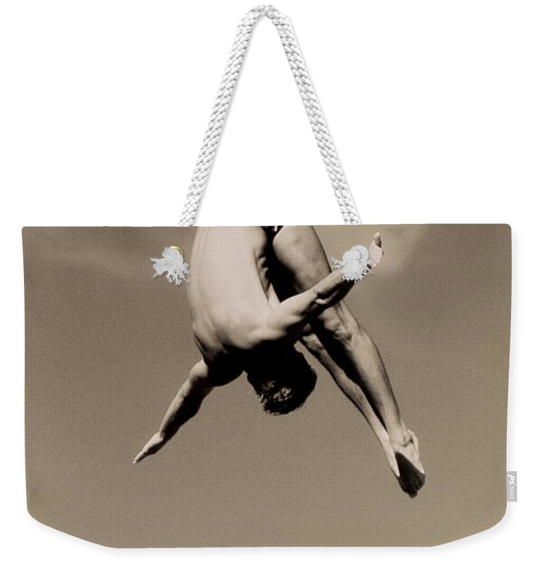 Diving Into Water Weekender Tote Bag featuring the photograph Male Diver In Mid-air by David Madison