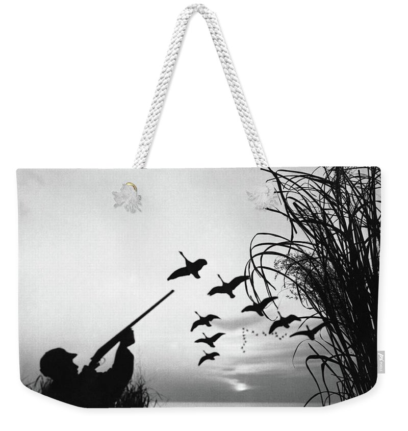 Rifle Weekender Tote Bag featuring the photograph Man Duck-hunting by Stockbyte