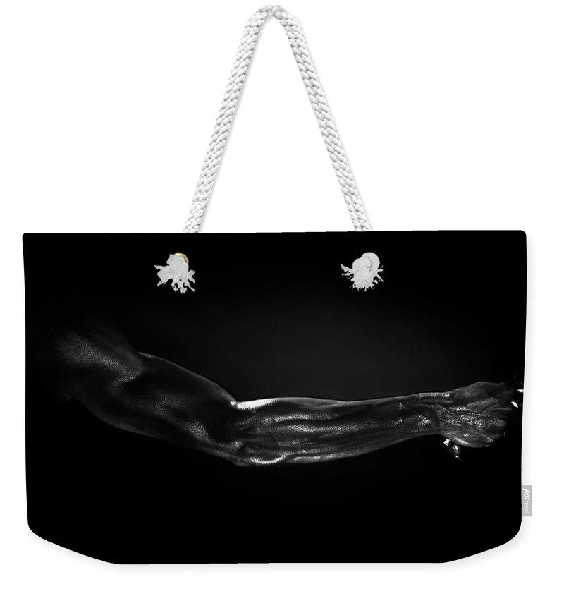 Human Arm Weekender Tote Bag featuring the photograph Man Holding Tennis Racket, B&w Digital by Hans Neleman