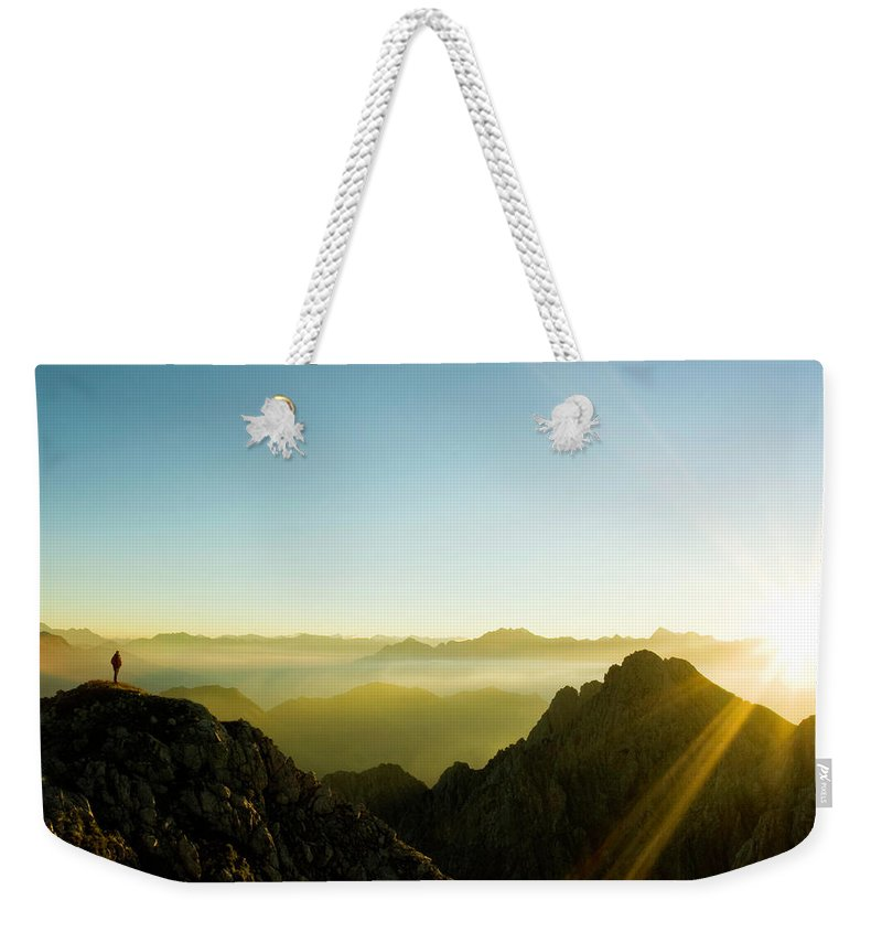 Dawn Weekender Tote Bag featuring the photograph Man by Lopurice