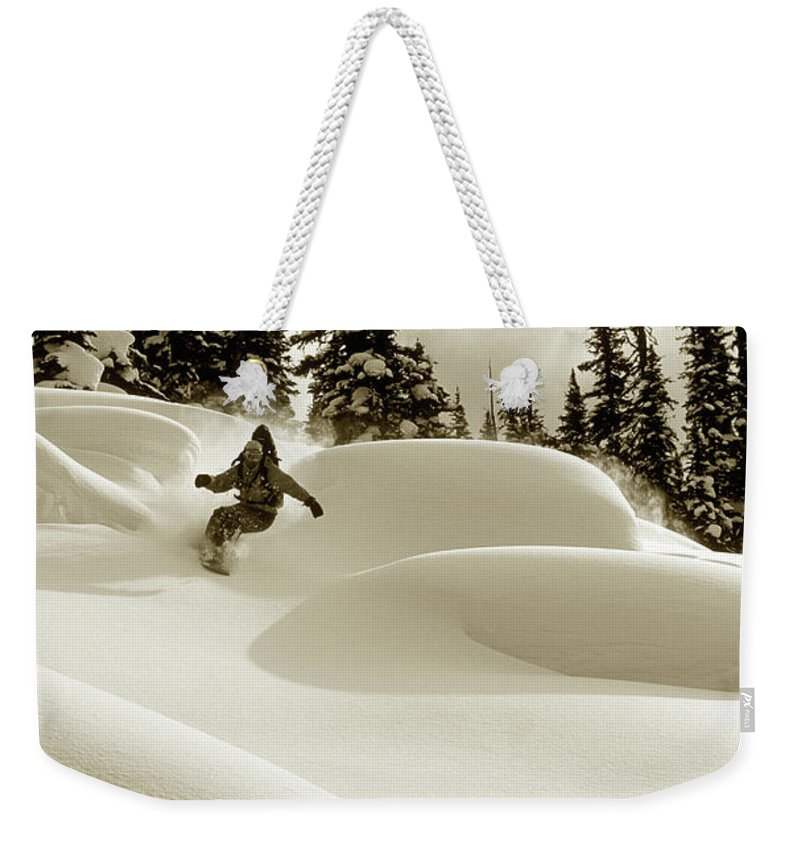 One Man Only Weekender Tote Bag featuring the photograph Man Snowboarding B&w Sepia Tone by Per Breiehagen