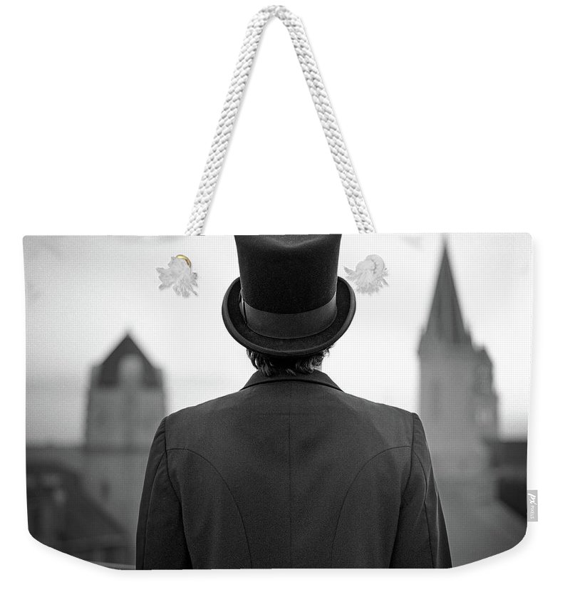 People Weekender Tote Bag featuring the photograph Man Standing Front Of Cathedral by Eddie O'bryan