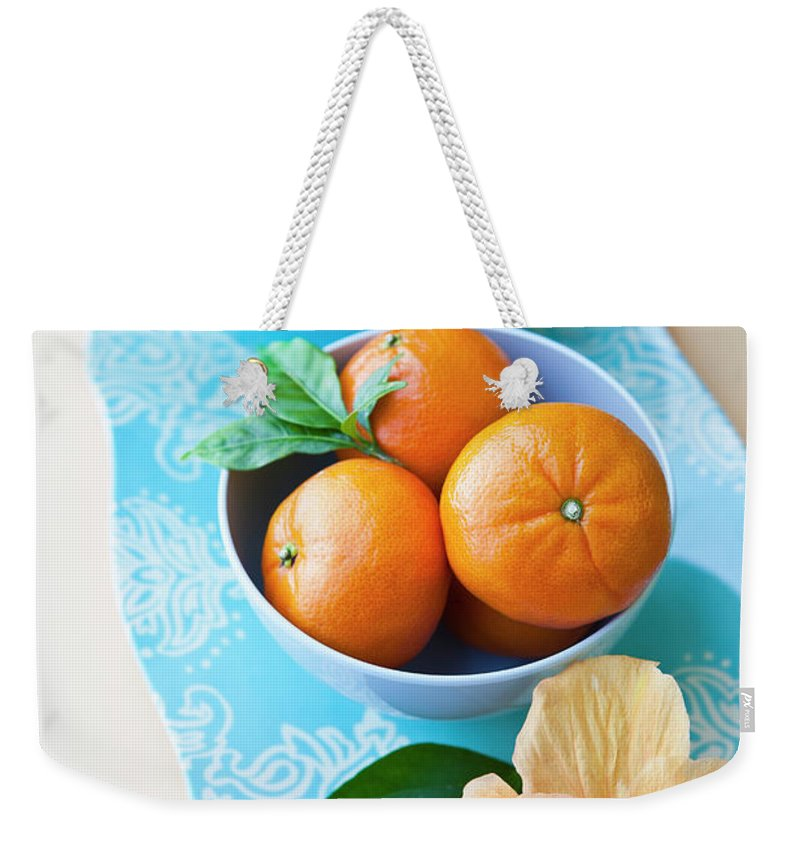 Florida Weekender Tote Bag featuring the photograph Mandarin Oranges On A Platter by Pam Mclean