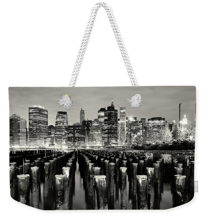 Wooden Post Weekender Tote Bag featuring the photograph Manhattan At Night by Shobeir Ansari