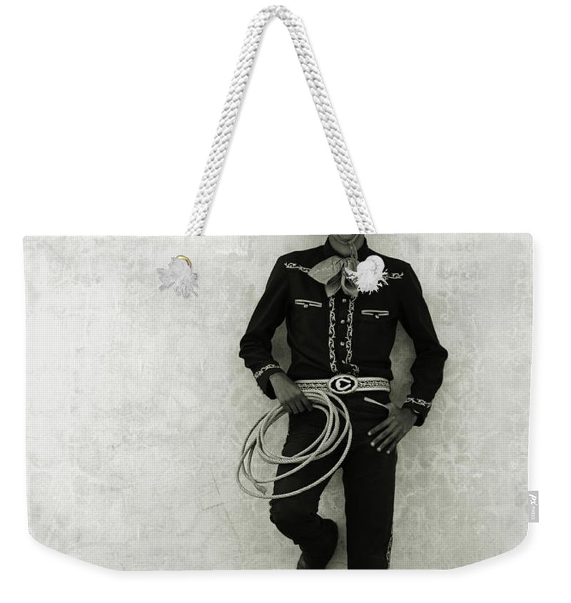 Cool Attitude Weekender Tote Bag featuring the photograph Mexican Cowboy Wearing Hat And Holding by Terry Vine