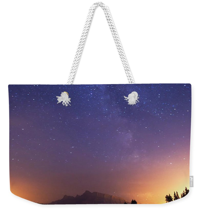 Social Issues Weekender Tote Bag featuring the photograph Milky Way In Banff by Dan prat
