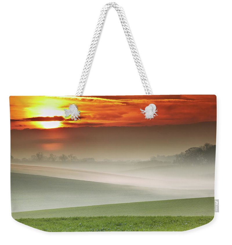 Tranquility Weekender Tote Bag featuring the photograph Mist Over Landscape Of Rolling Hills by Andy Freer