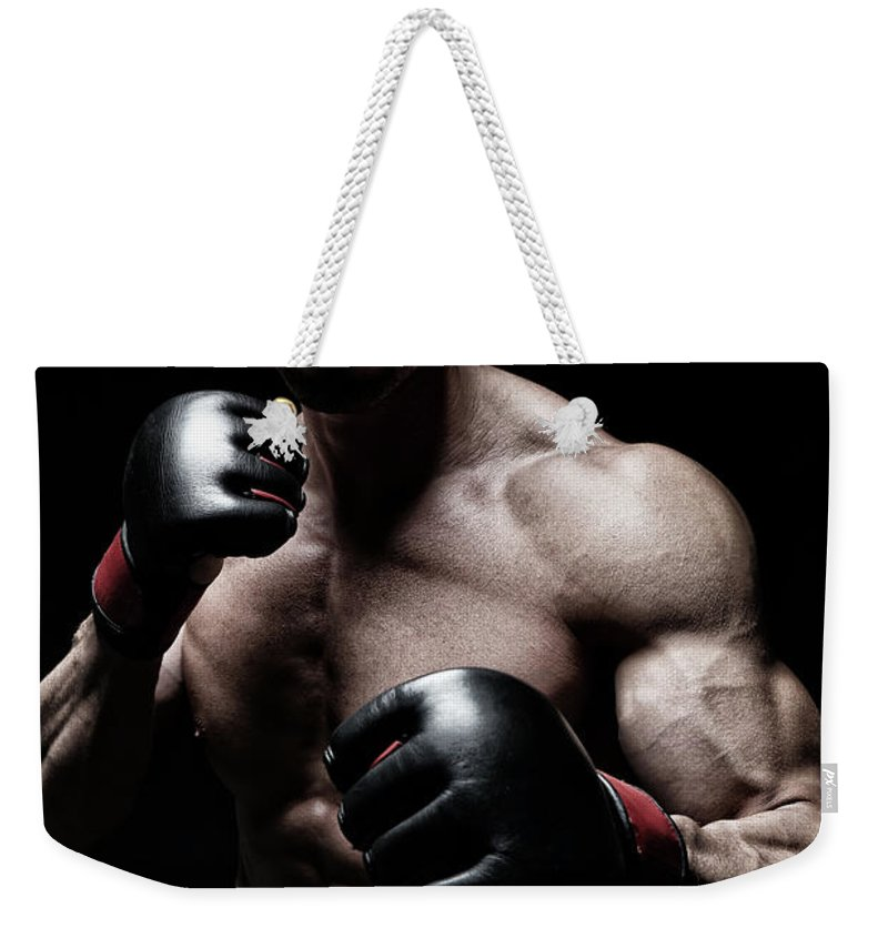 Toughness Weekender Tote Bag featuring the photograph Mma Fighter by Vuk8691