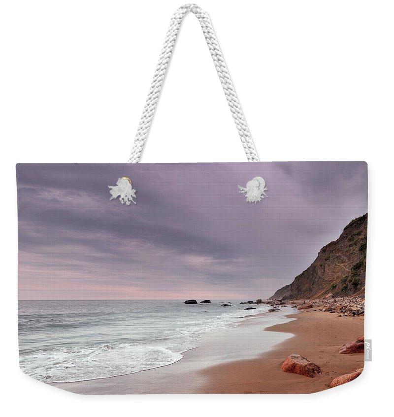 Water's Edge Weekender Tote Bag featuring the photograph Mohegan Bluffs Beach- Block Island by Shobeir Ansari