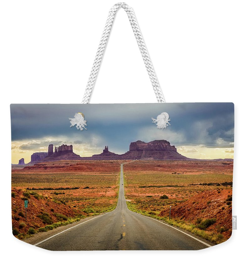 Scenics Weekender Tote Bag featuring the photograph Monument Valley by Posnov