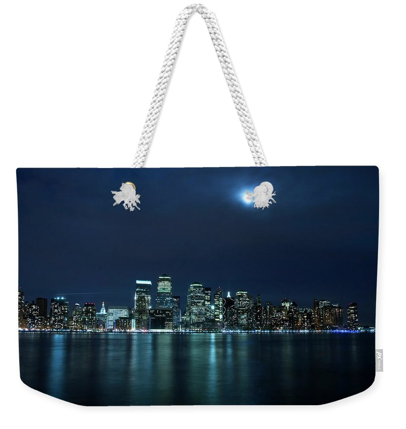Lower Manhattan Weekender Tote Bag featuring the photograph Moon Light Over New York City by Brandonj74