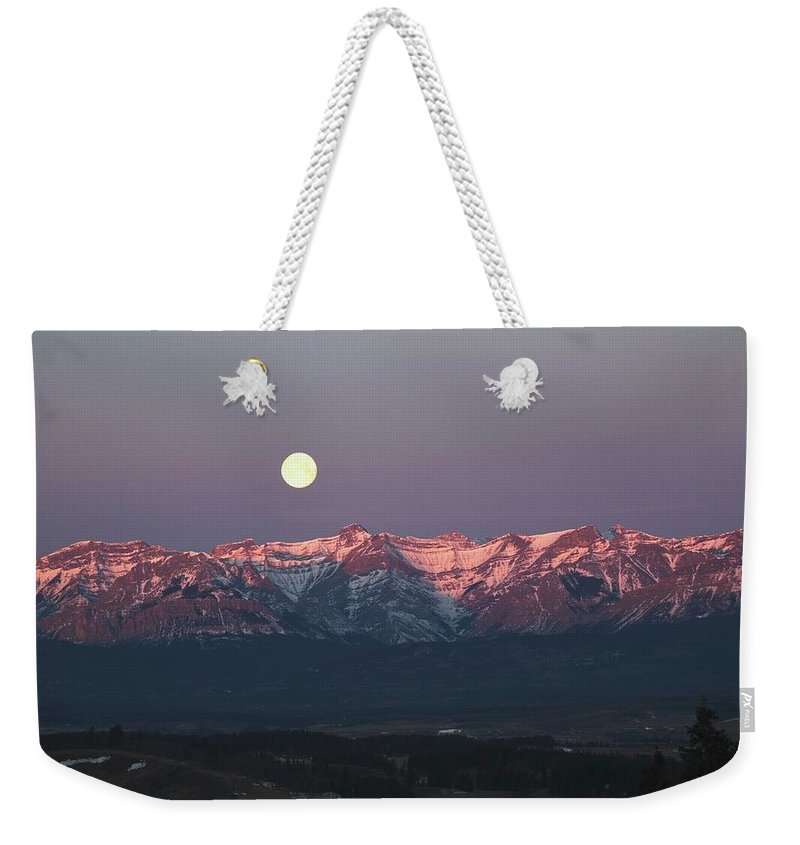 Front Range Weekender Tote Bag featuring the photograph Moon Set Over Front Range Mountains by Design Pics / Michael Interisano