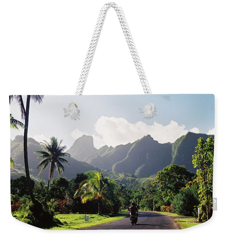 Shadow Weekender Tote Bag featuring the photograph Motorcyclist On Polynesian Road by Ejs9