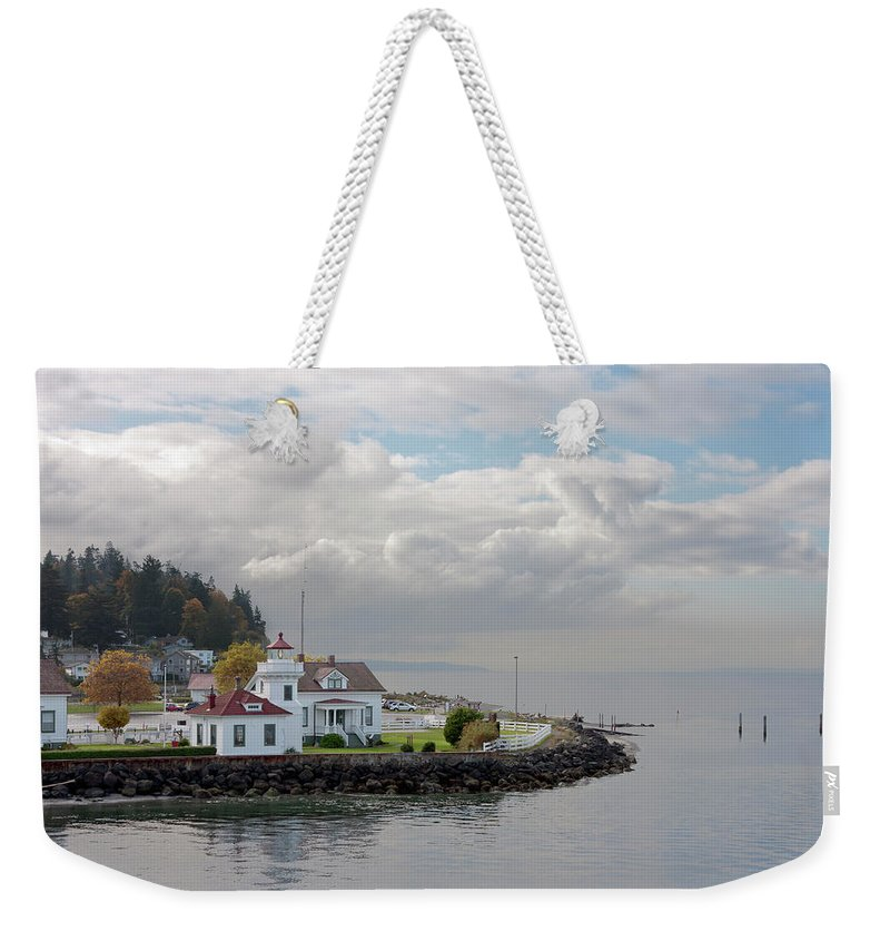Water's Edge Weekender Tote Bag featuring the photograph Mukilteo Lighthouse On Puget Sound by Stevedf