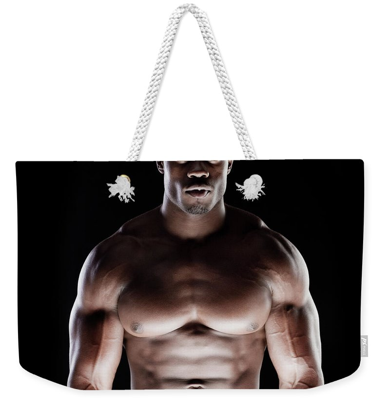 Young Men Weekender Tote Bag featuring the photograph Muscular Man by Pkline