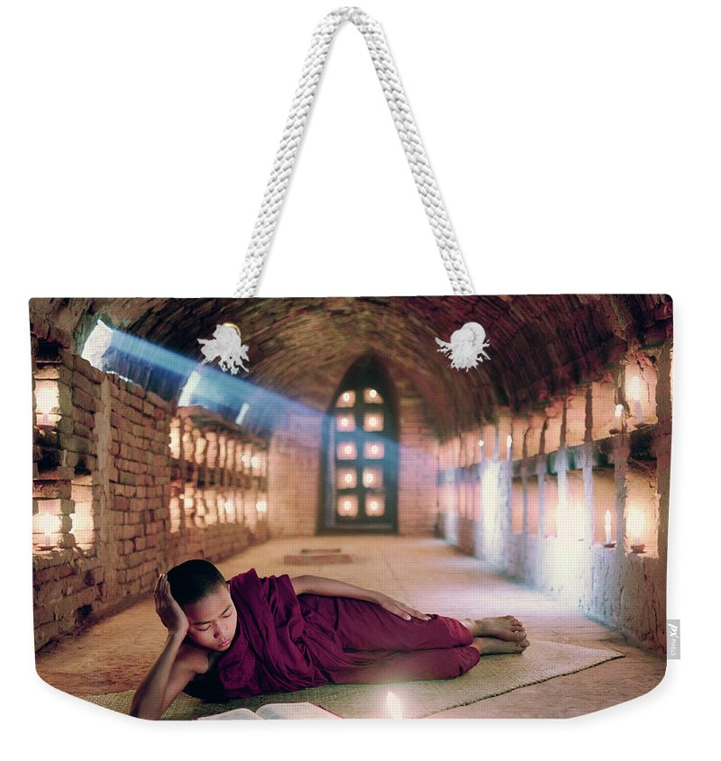 Child Weekender Tote Bag featuring the photograph Myanmar, Buddhist Monk Inside by Martin Puddy