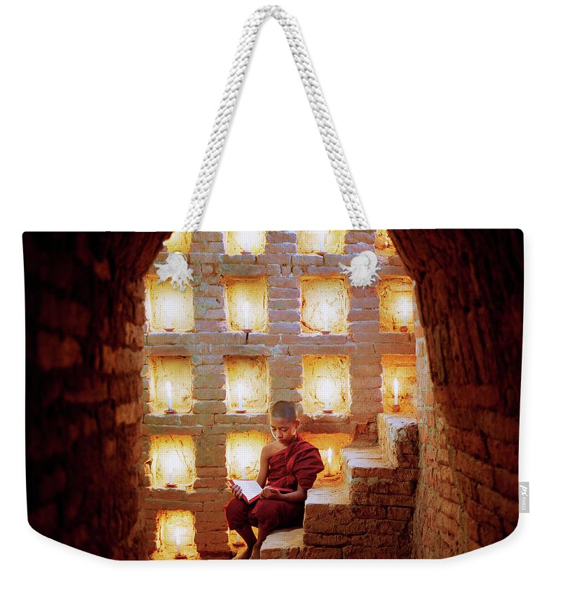 Arch Weekender Tote Bag featuring the photograph Myanmar, Buddhist Monk Inside Temple by Martin Puddy