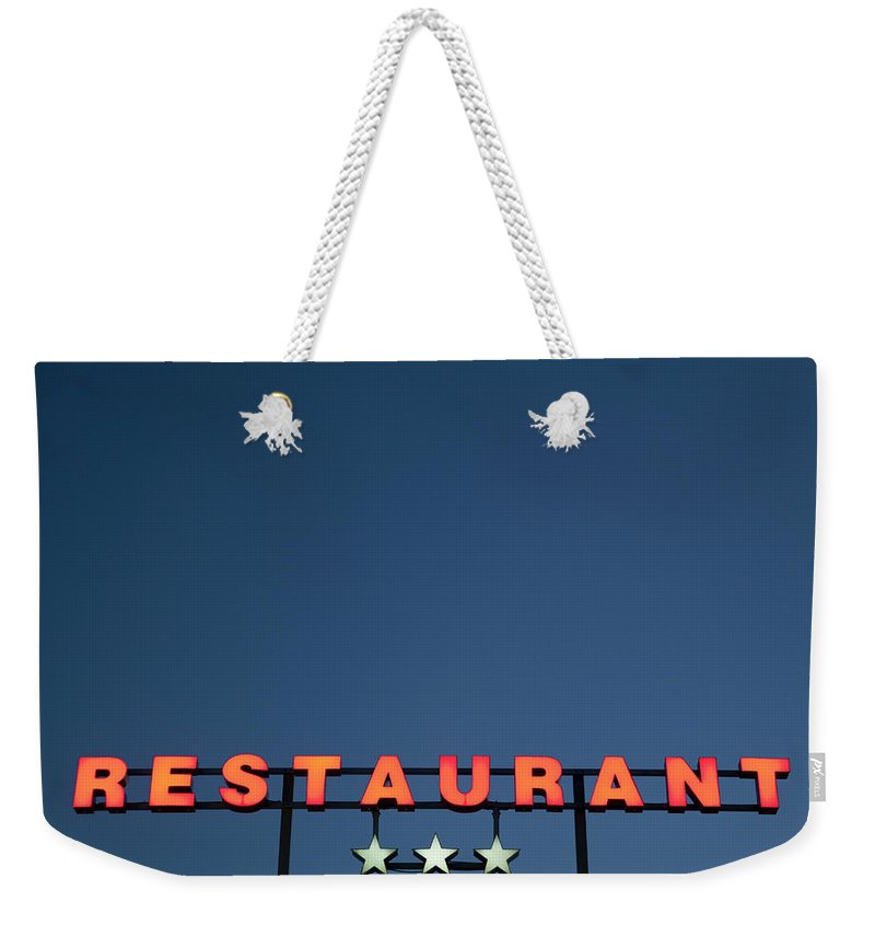 Temptation Weekender Tote Bag featuring the photograph Neon 3 Star Restaurant Sign by Henglein And Steets