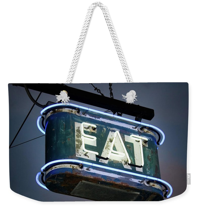 Hanging Weekender Tote Bag featuring the photograph Neon Eat Sign by Kjohansen