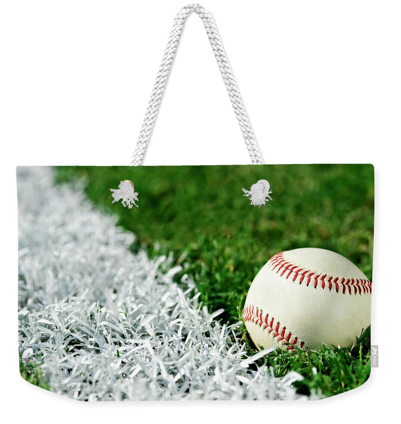 Grass Weekender Tote Bag featuring the photograph New Baseball Along Foul Line by Cmannphoto