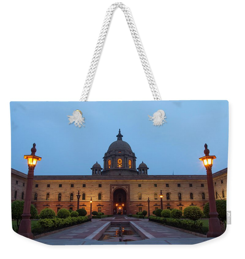 New Delhi Weekender Tote Bag featuring the photograph New Delhi President House At Night by Prognone