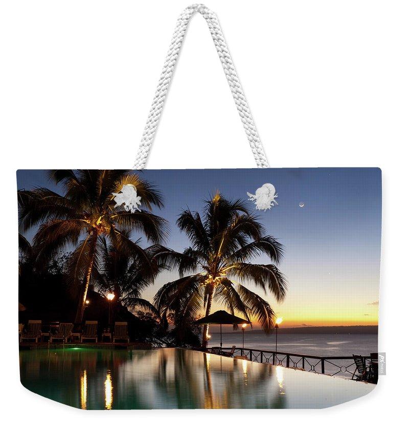 Swimming Pool Weekender Tote Bag featuring the photograph Nightfall At Iririki Island, Vanuatu by Holgs