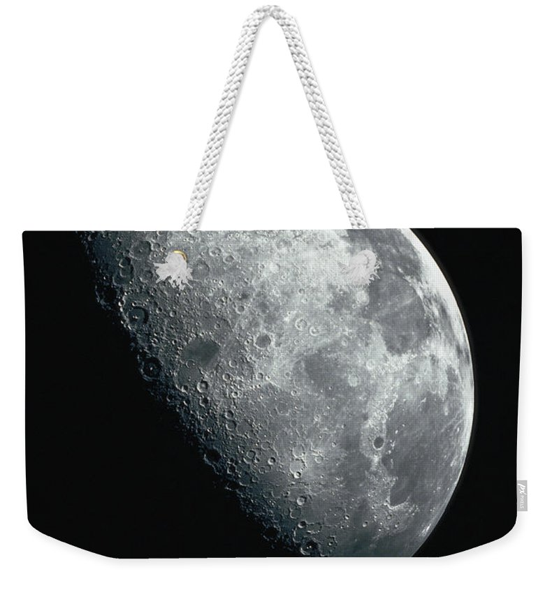 Clear Sky Weekender Tote Bag featuring the photograph North Pole Of The Earths Moon by Stocktrek