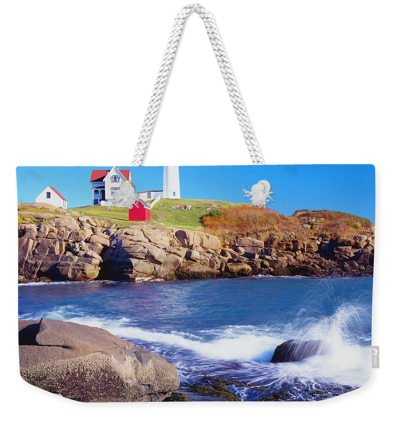 Water's Edge Weekender Tote Bag featuring the photograph Nubble Lighthouse And Coastine Of Maine by Ron thomas