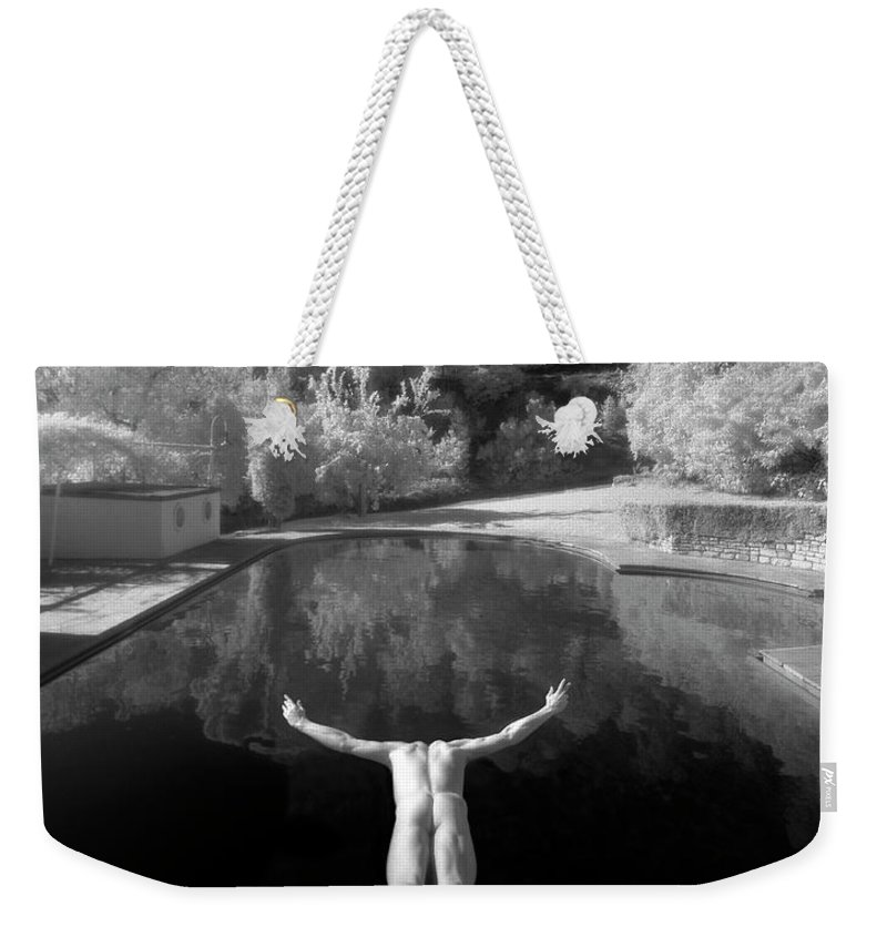 Diving Into Water Weekender Tote Bag featuring the photograph Nude Male Diving Into Dark Poolicarus by Ed Freeman