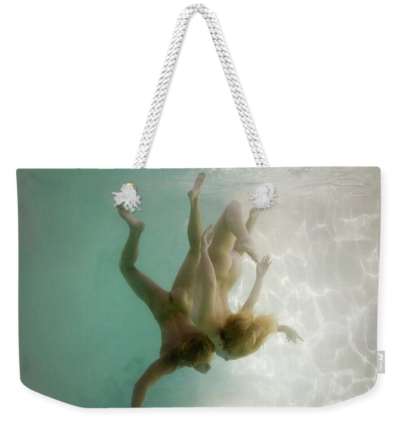 Young Men Weekender Tote Bag featuring the photograph Nude Man And Woman Underwater by Ed Freeman