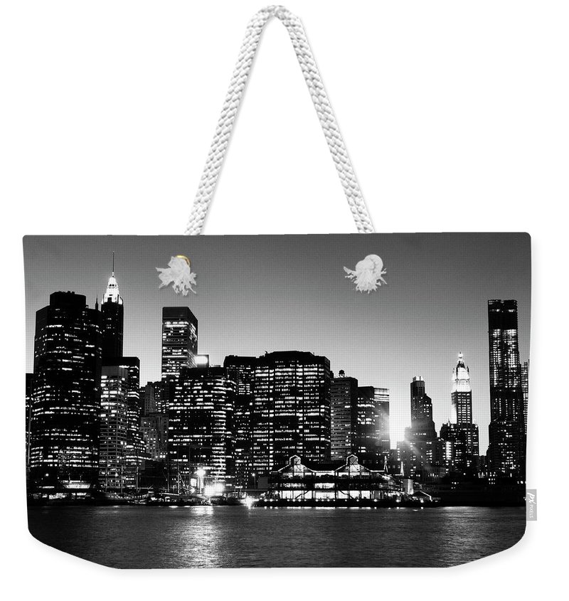 Lower Manhattan Weekender Tote Bag featuring the photograph Nyc Skyline At Sunset by Lisa-blue