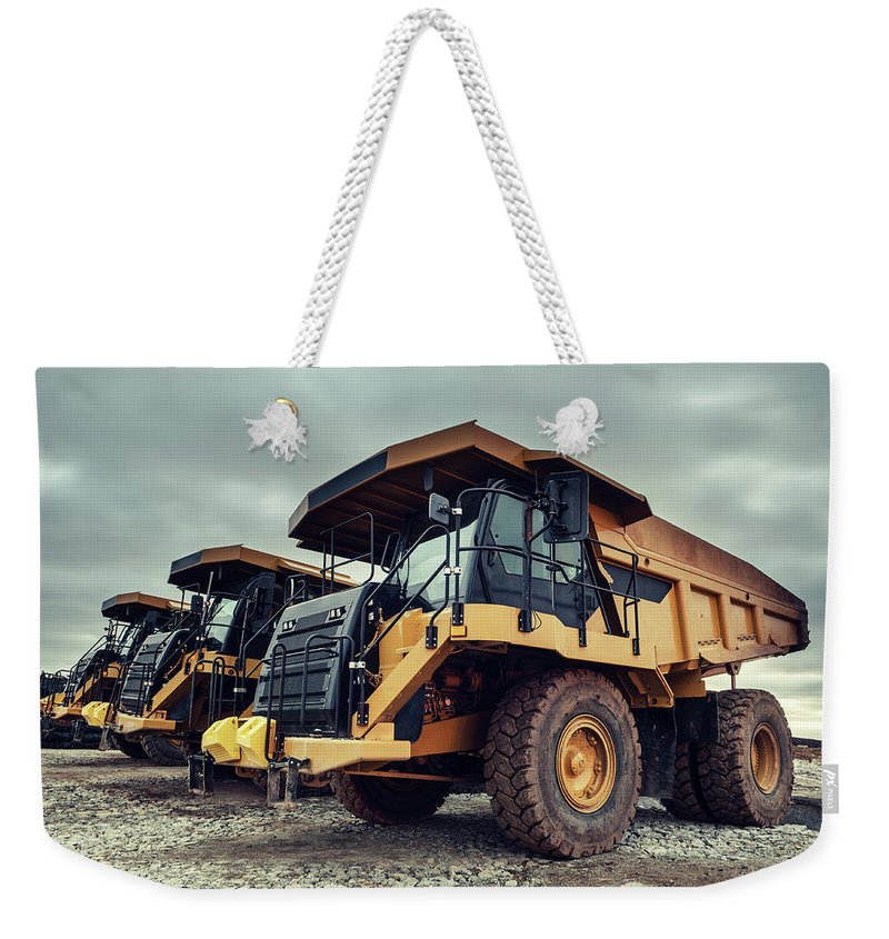 Construction Machinery Weekender Tote Bag featuring the photograph Off-highway Dump Trucks by Shaunl